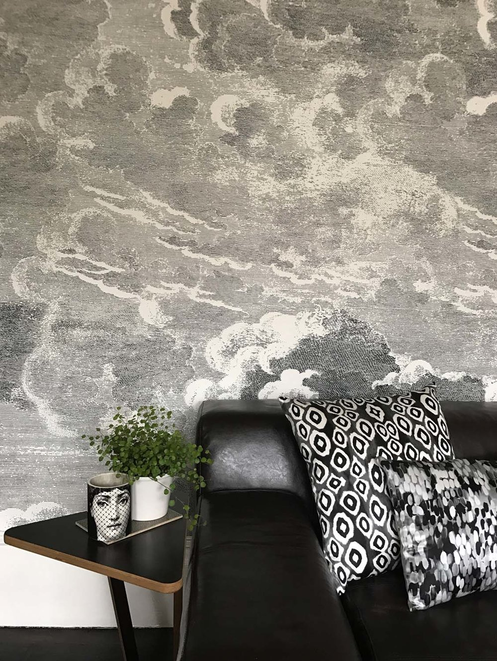 Fornasetti clouds wallpaper in a living room