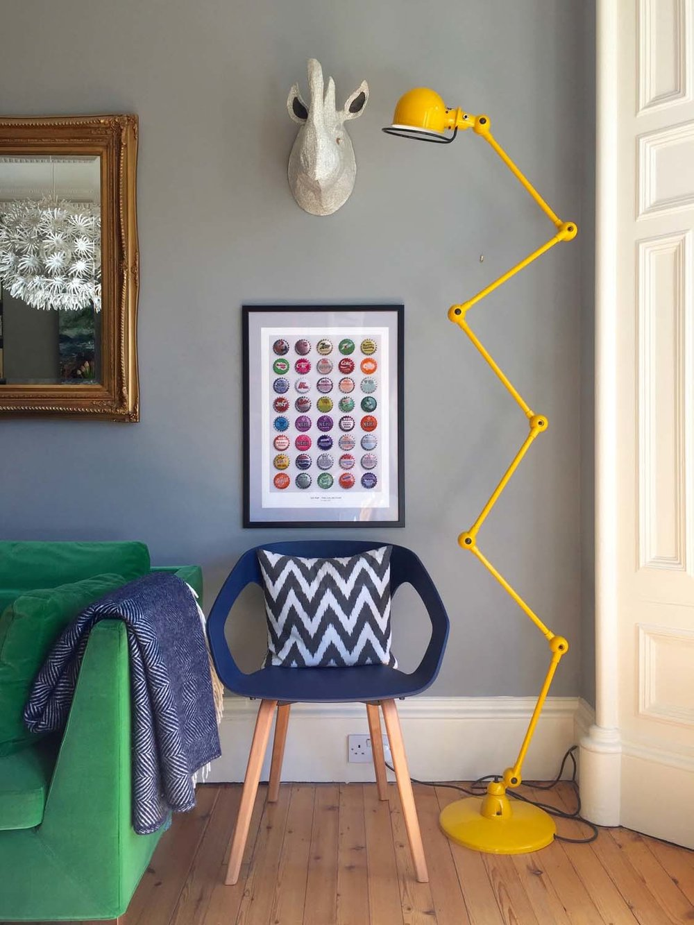 Go Pop The Collection print, Tom Love; Yellow lamp, Jielde; Rhino head, Anthropologie; Sofa, IKEA; Rug, Cox & Cox
