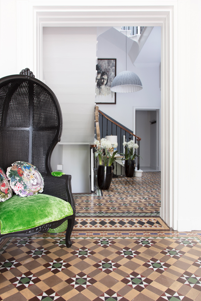 The hallway (those tiles!), with a chair Anna designed herself and sells on PAD/Photo: Susie Lowe