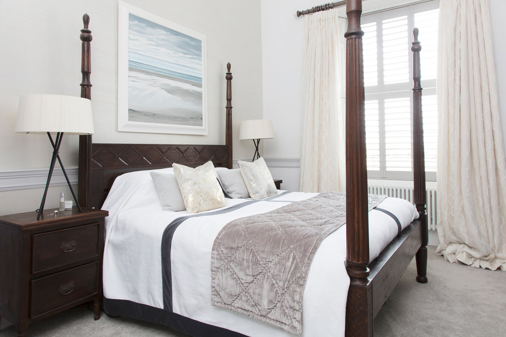 Anna's master bedroom with Jonathan Adler splatter cushions and Kelly Hoppen bedspread/Photo: Susie Lowe