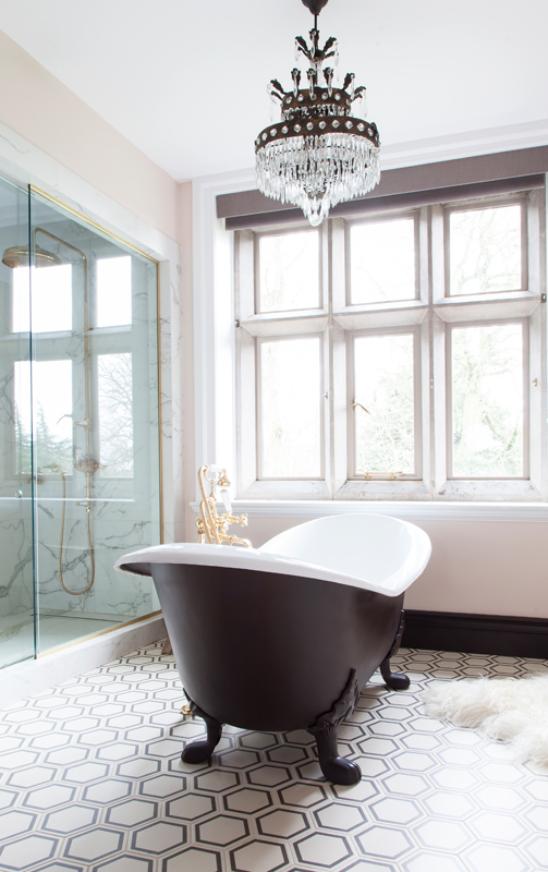 The Cast Iron Bath Company claw-footed bath with brass taps and hexagonal tiles/Photo: Susie Lowe