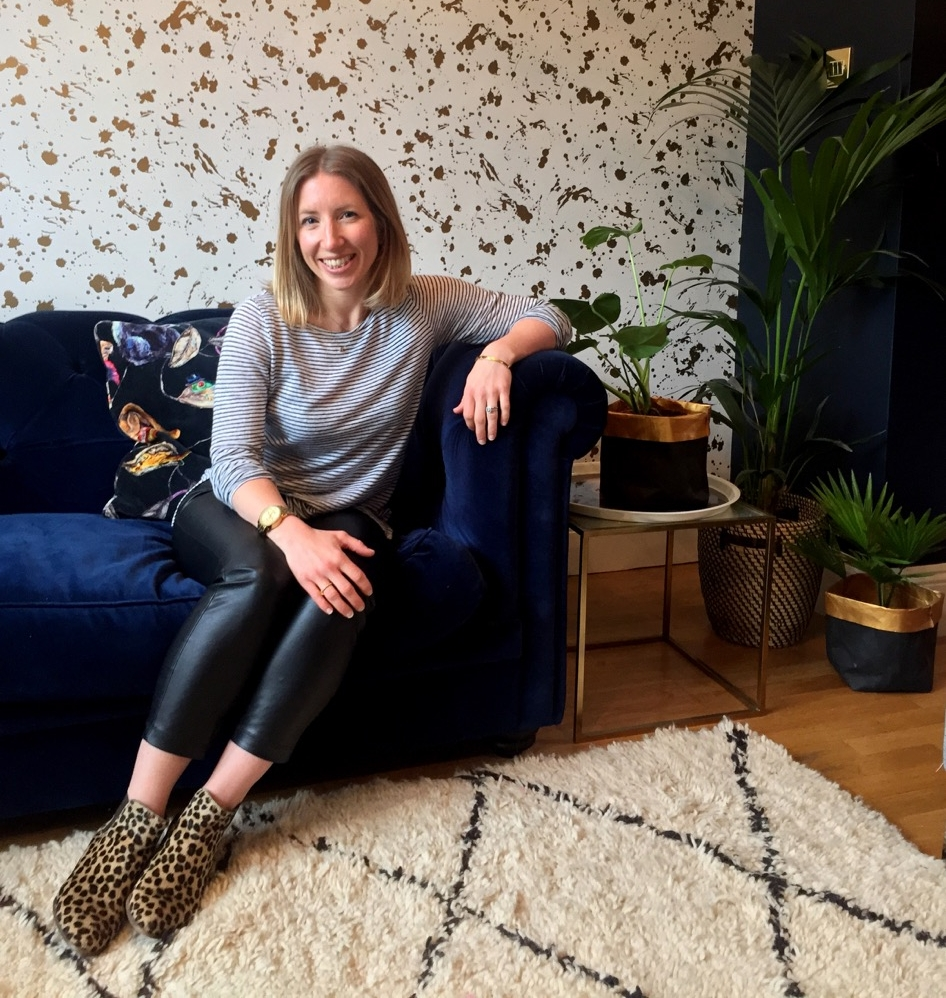 Jess with her biggest decor triumph: Jonathan Adler gold Drip wallpaper