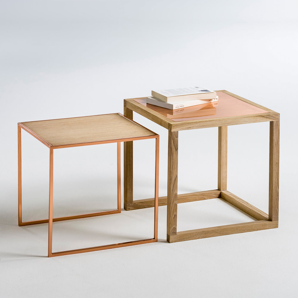 Elori Tables - This vintage-inspired nest of two copper-and-oak tables is super versatile, plus they look like they should cost twice as much as they do. I predict a sell out