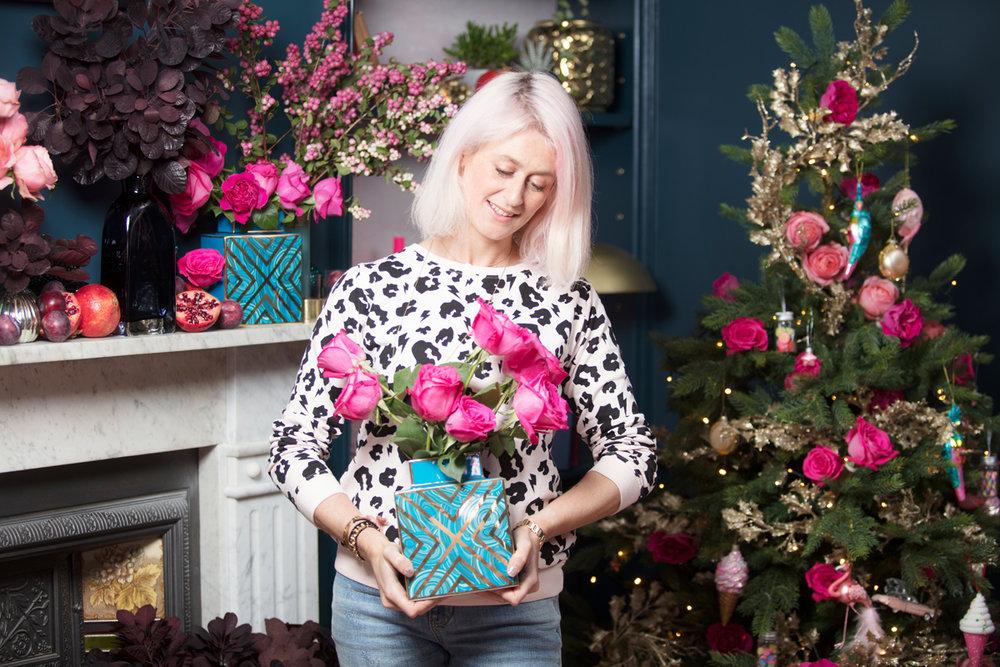 Pink roses in a blue malachite Jonathan Adler vase