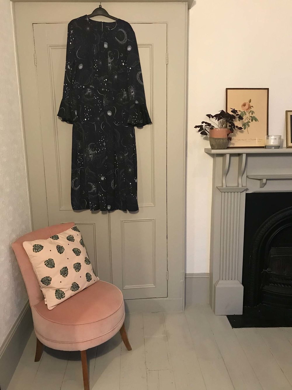 A corner of Clemmie and Simon's bedroom, complete with reupholstered vintage chair, and Elizabeth Scarlett cushion