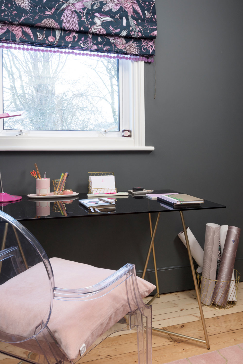 Made Patrizia brass and smoked glass desk with Emma J Shipley Animalia pink fabric blind
