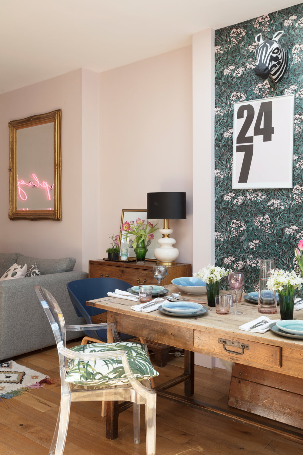 vintage dining table and pink neon sign in the dining room