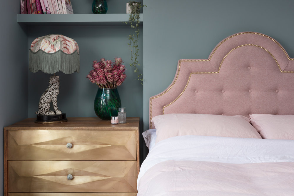 Hypnos pink headboard with brass studs designed by Emily Murray from The Pink House
