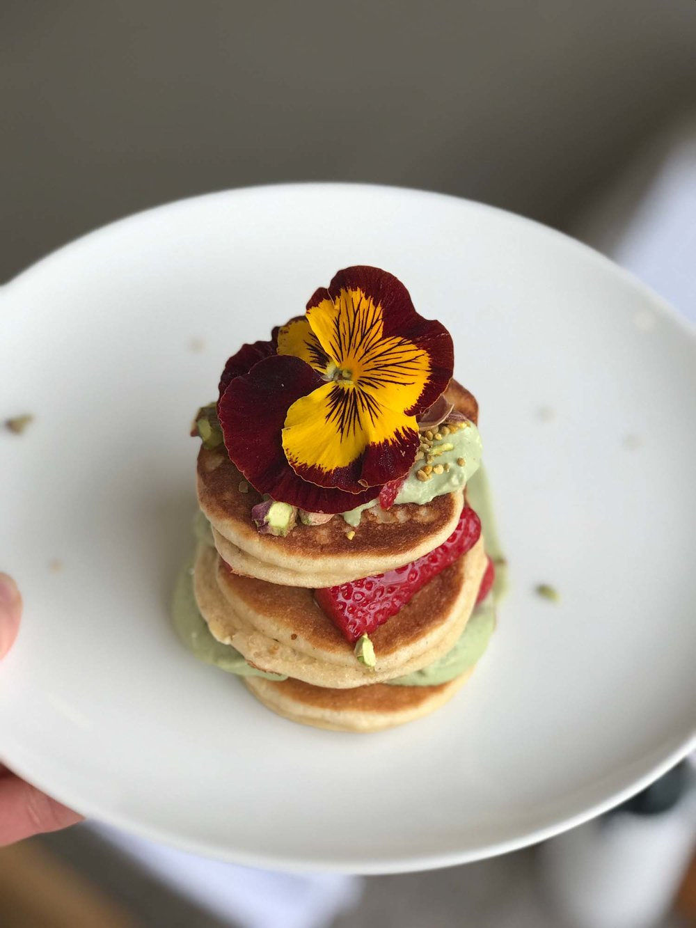 Ben's dairy-free and delicious almond pancakes with matcha cream and strawberries