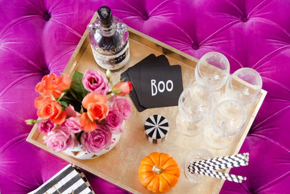 Pink adults Halloween party drinks tray styling