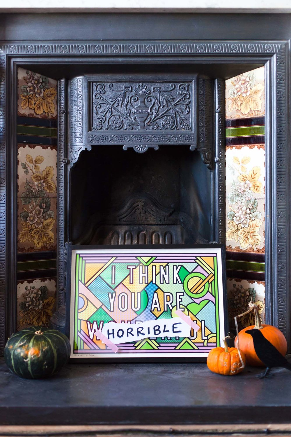 Halloween styled fireplace with pumpkins