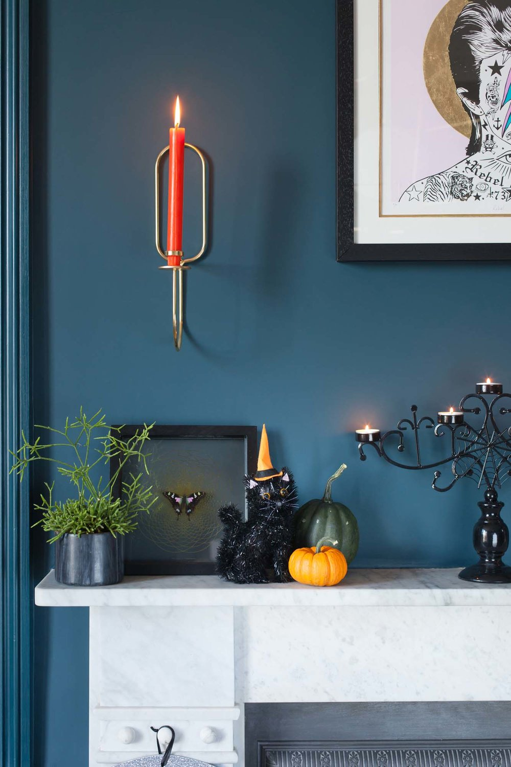 Orange candles and black Sainsbury's candelabra for Halloween