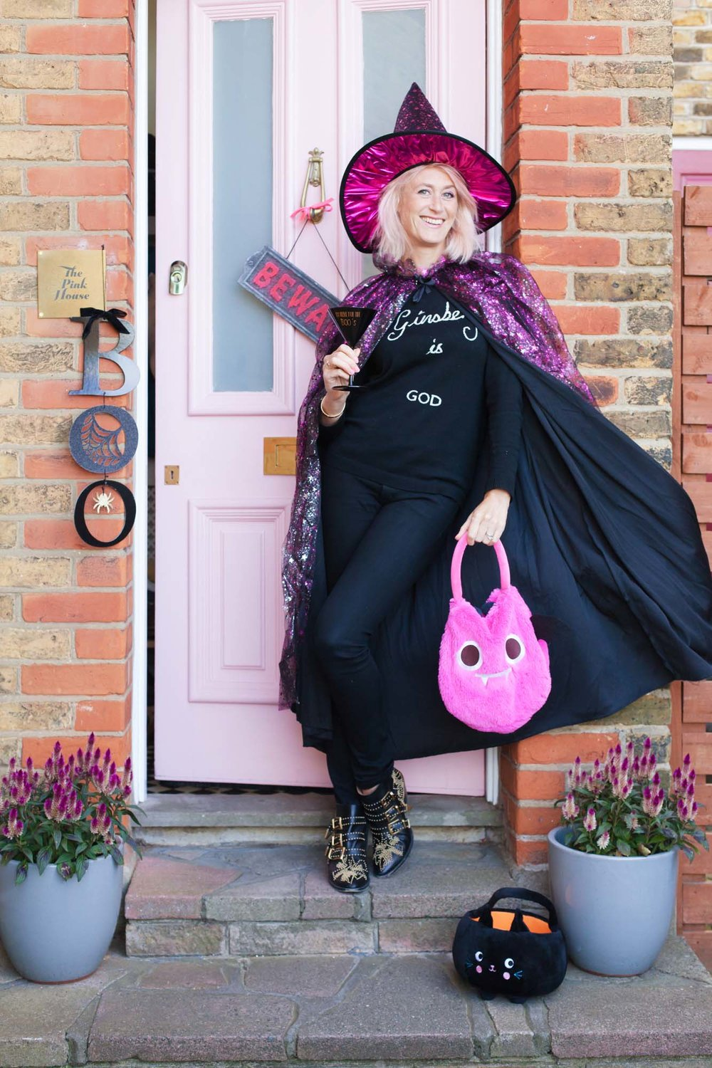 Emily Murray from The Pink House in a Sainsbury's Tu pink witch Halloween costume