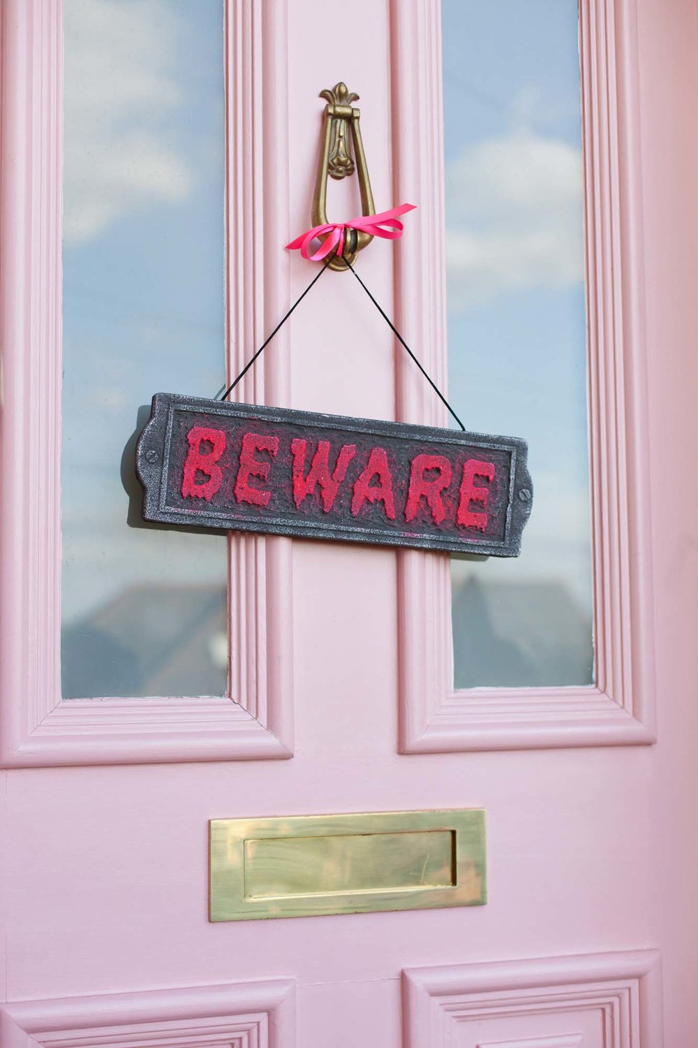 Farrow & Ball Nancy's Blushed pink front door with Beware sign
