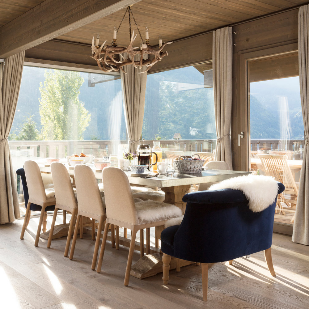 This photo of Chalet Mirabelle's dining space with beautiful views was taken in the summer - our view was rather more snowy