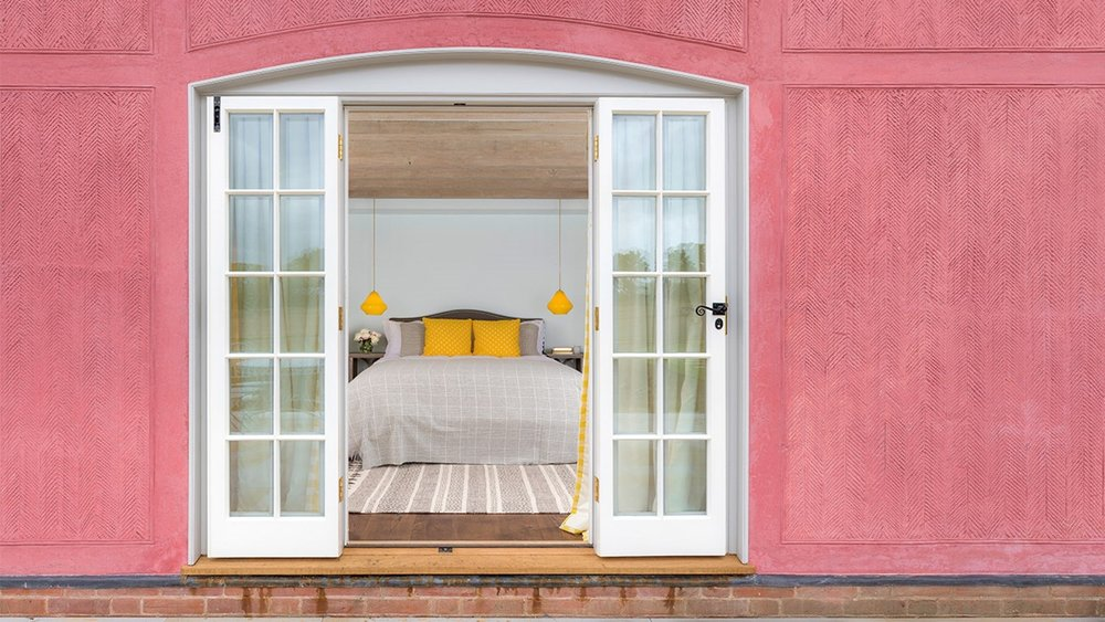 The pink theme runs throughout, with splashes of yellow in the bedrooms