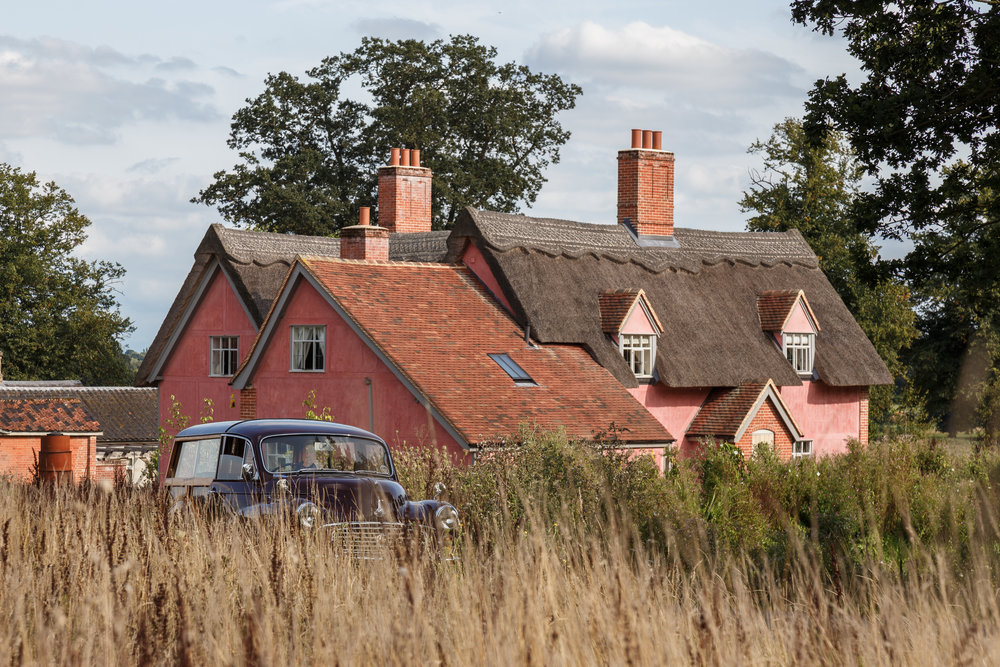 The pink hue of the Farmhouse's exterior is known as 'Suffolk Pink', a finish common to historical homes in the area