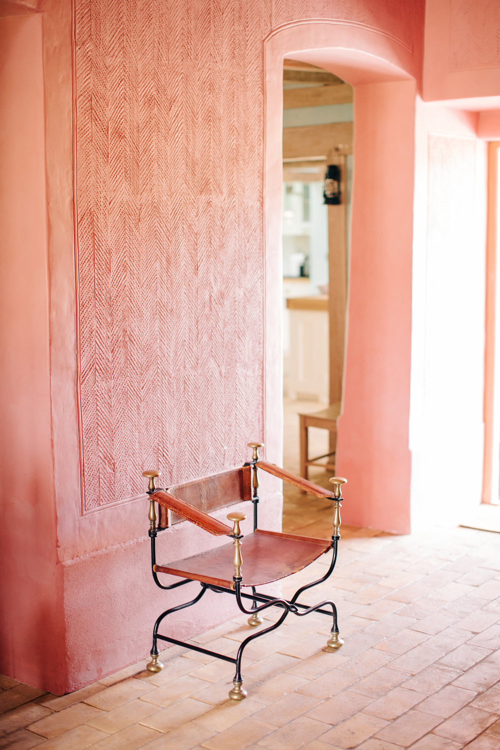 The Farmhouse's intricate details and carvings - and more pink!