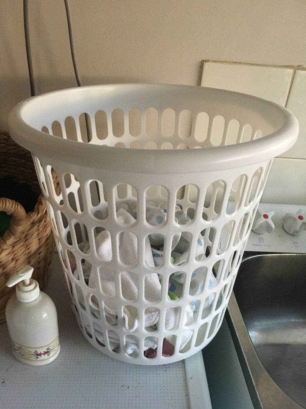 Our laundry basket: we store our cloth nappies in a separate  basket to keep our other washing clean