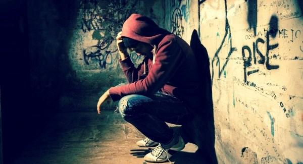 Depressed man on sidwalk
