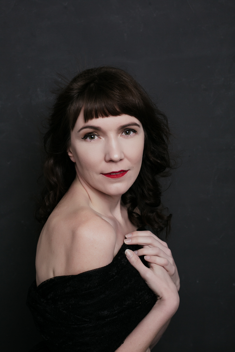 studio portrait of a woman in red lipstick in a contemporary beauty style