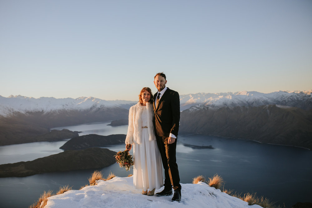 Donna wears a two piece  Custom Bridal  dress styled with gold boots and white fur coat.
