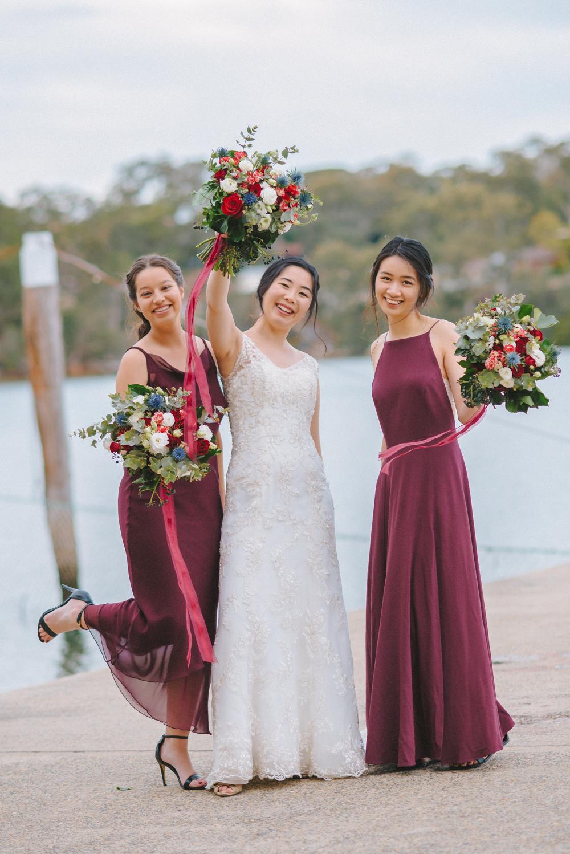 Burgundy bridesmaid dresses and bouquet wedding colour palette