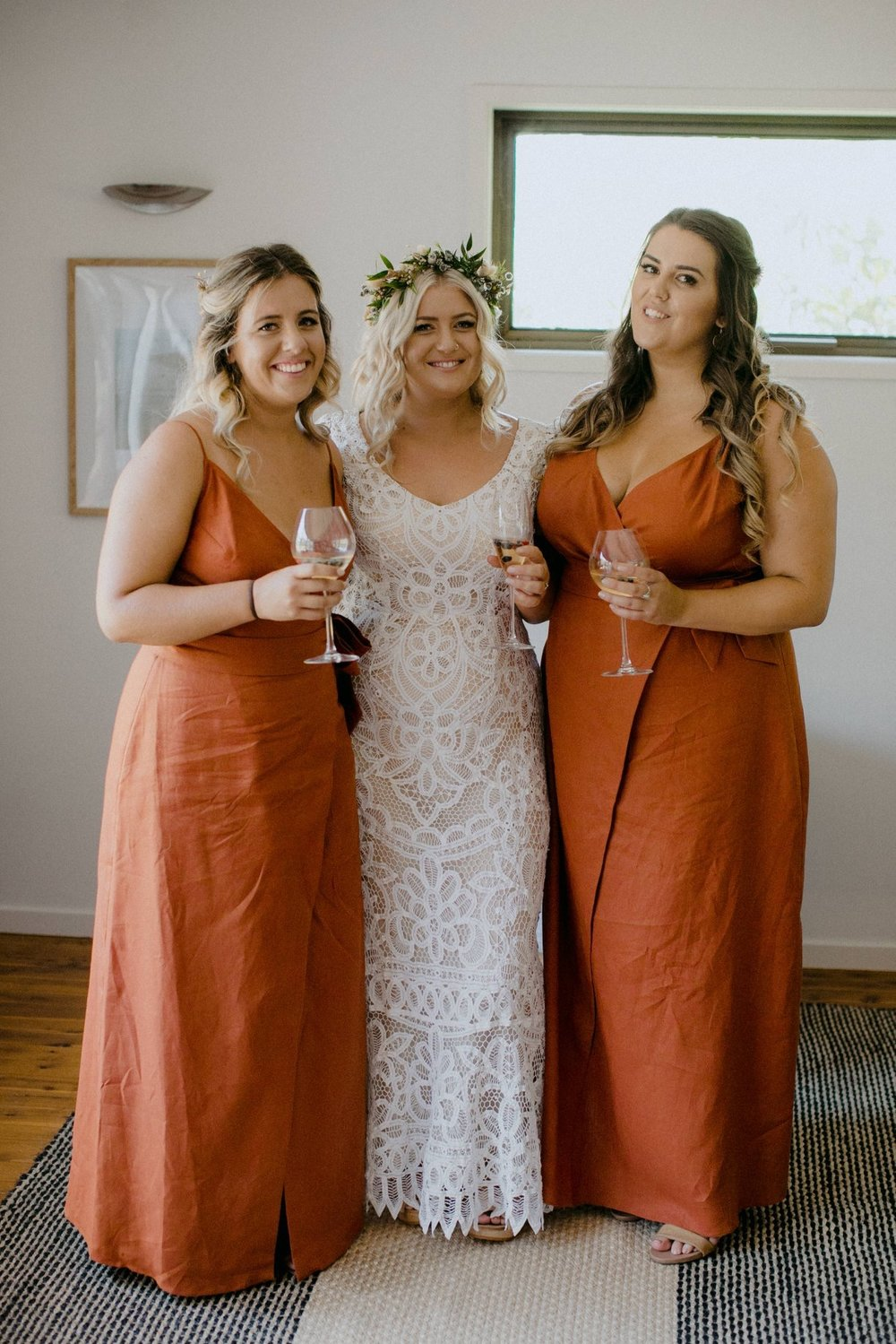 Bride with bridesmaids in paprika linen dresses