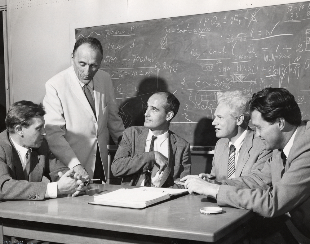 Keith Symon (seated at center) with visiting Soviet scientists. Vladimirsky (on far left), Kolominsky, and Dimitriefsky. Photo: University of Wisconsin Madison Archives