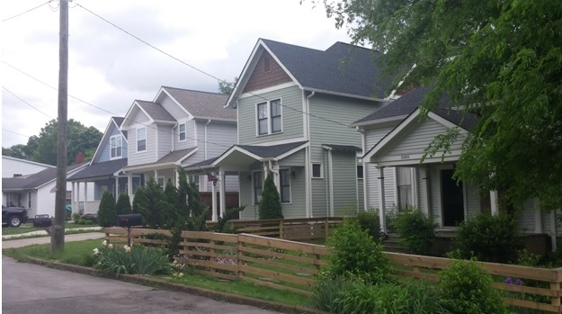Row of remodeled and new construction homes on Illinois Ave