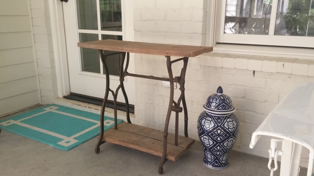 An old sewing machine frame found in grandma's basement. Added reclaimed wood to repurpose for a table.