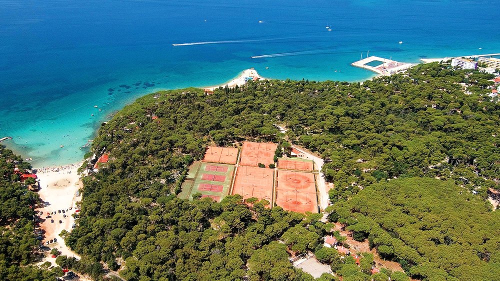 Sun soaked red clay tennis courts in Biograd na Moru, Zadar Region