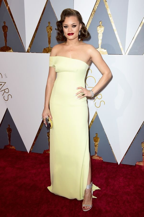 Singer Andra Day gave us classic Hollywood glam with a one-shoulder yellow dress by SAFiYAA and jewelry by Swarovski.