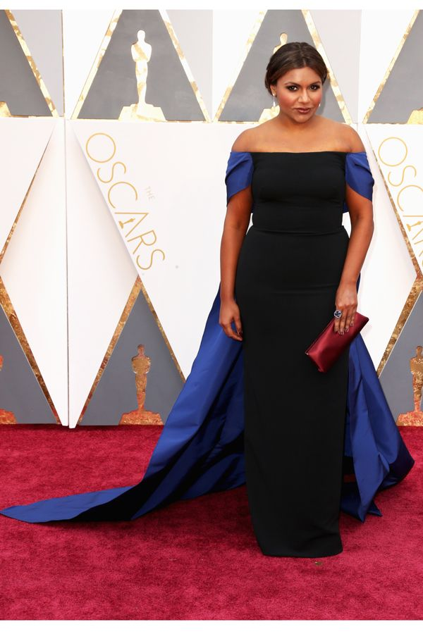 Actress Mindy Kaling looked bomb in a black gown with royal blue long-train by Elizabeth Kennedy and jewelry by Effy.