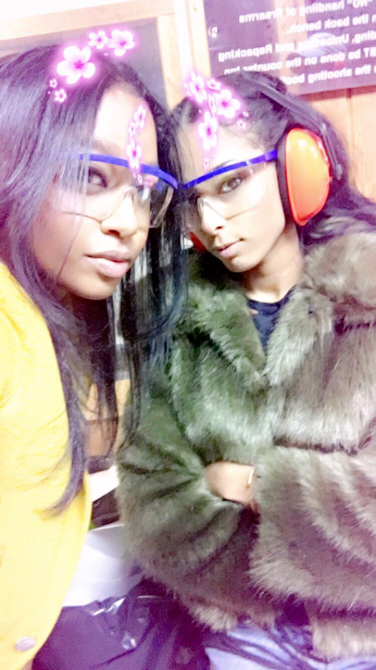 Malikah and I at the gun range