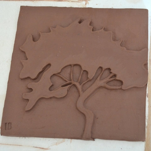 unfired stoneware tile by Beth McCubbin...example of size and carving techniques to be used in the Clay Project