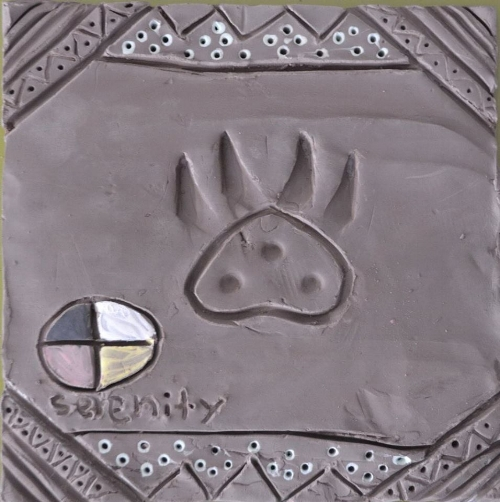 a tile made by a young teen, when asked by her mother whether that was a bear paw in the centre, she replied that she didn't know. I liked that answer very much