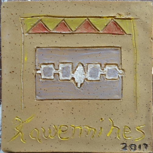 Kawennihes is the tile makers Mohawk name. The Iroquois Confederacy symbol is also seen in the centre of the tile.