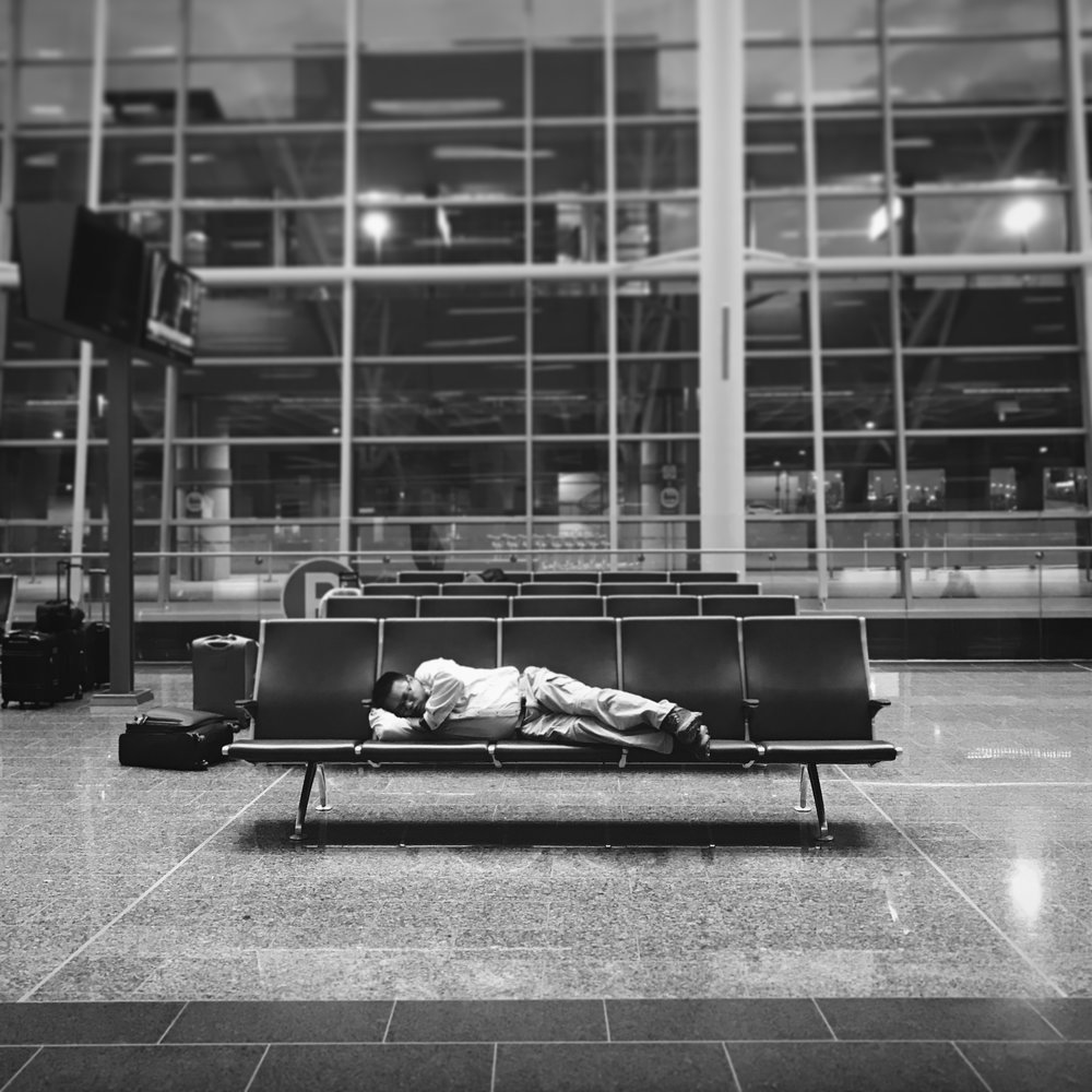 Saturday morning, Calgary airport. The flight landed after 3am and many of us were stranded here to wait and try to sleep until rental car companies opened again.