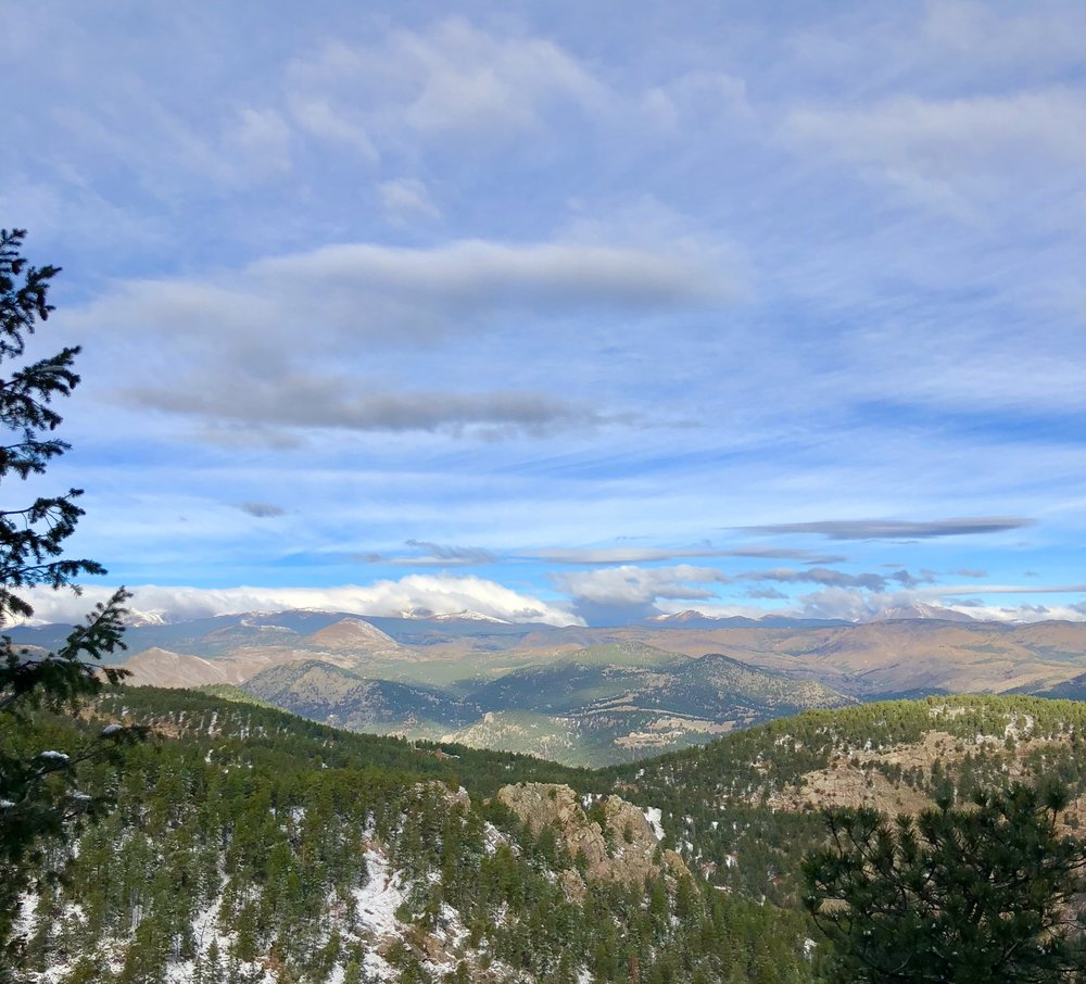 at the summit of a hike looking west towards the Rockies