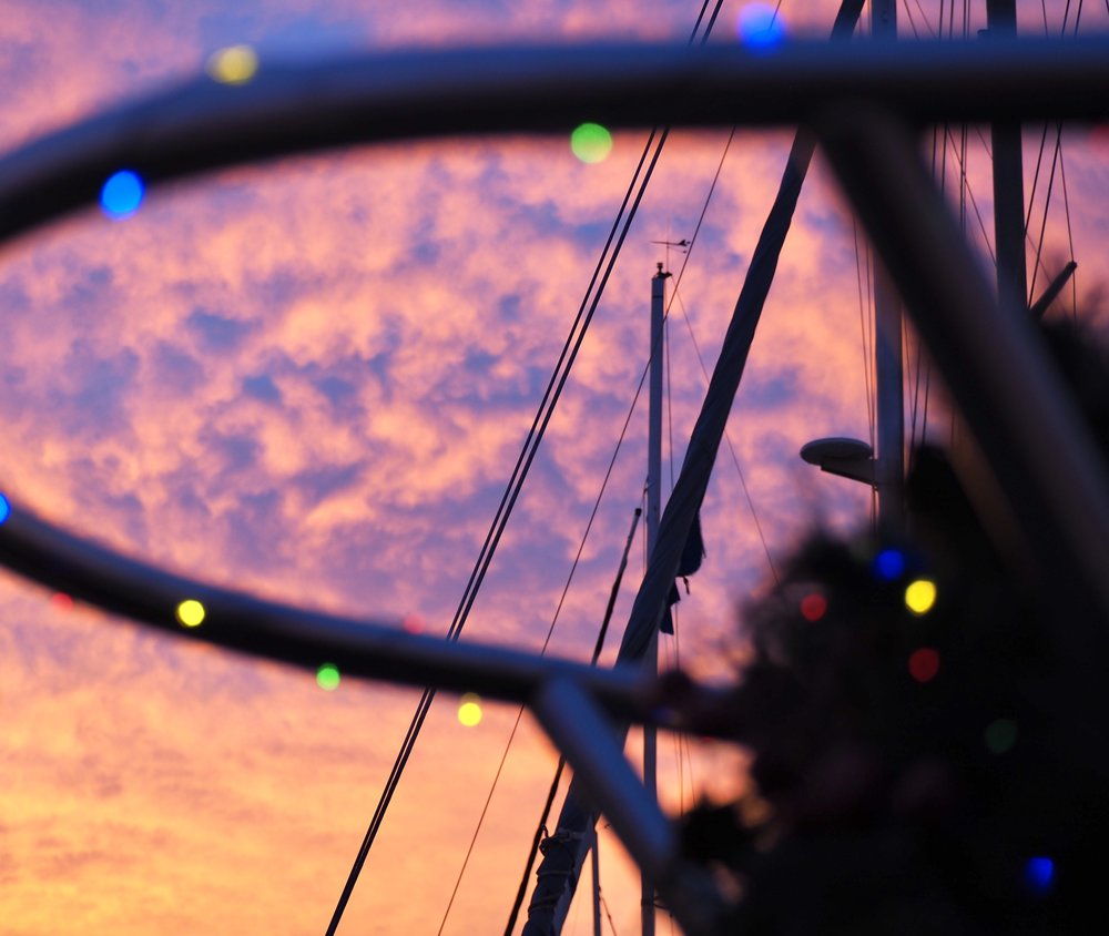 Sunset through the bow rail / wreath with lights