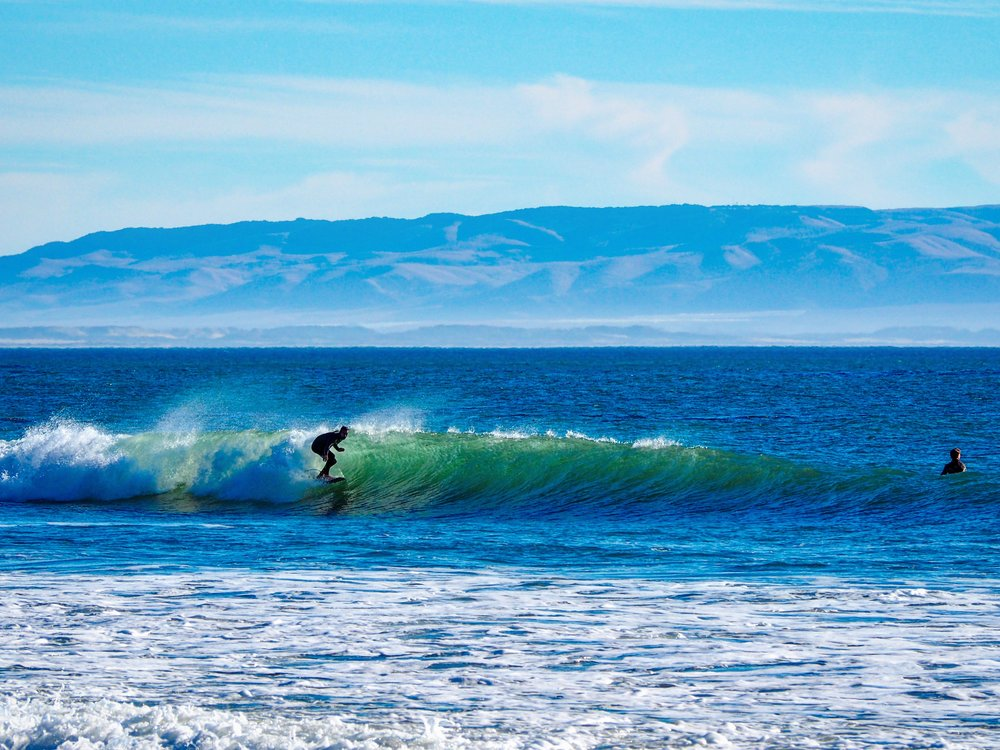 Mia snapped this photo of me surfing in Shell Beach