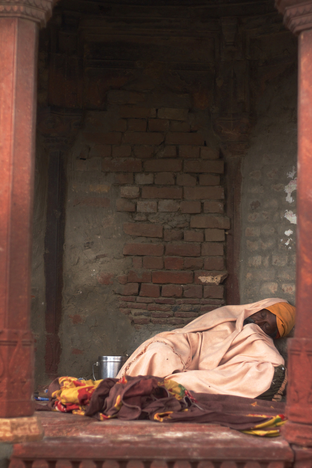 A man rests near the Radha Raman mandir in Vrindavan, India.
