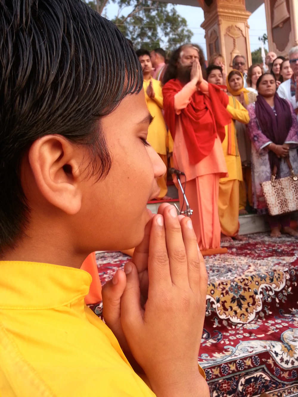 Hindu devotees sing and pray along the Ganges River.