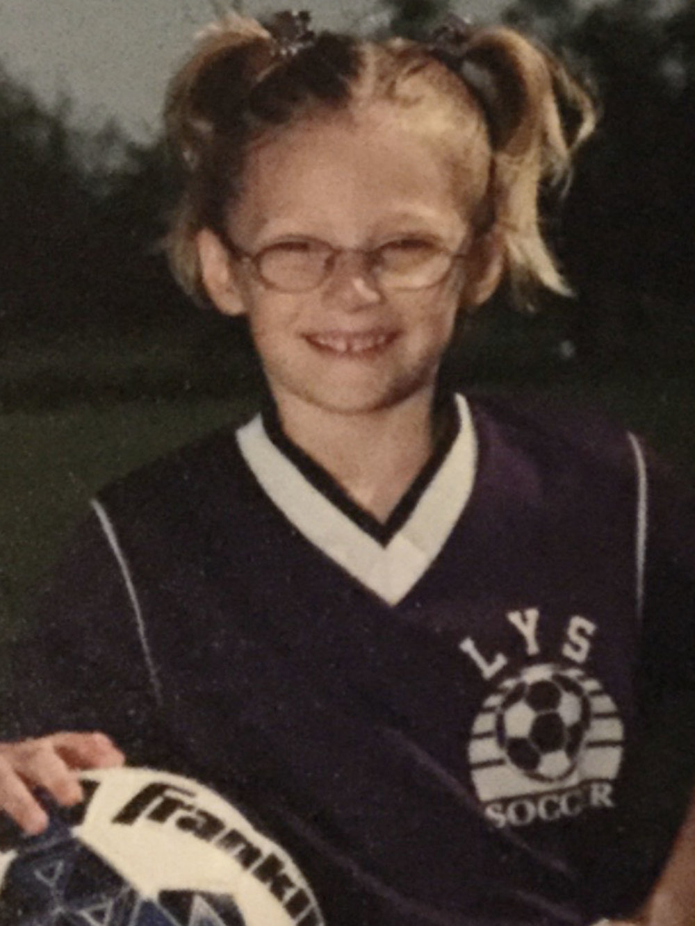 Good bye glasses - Because my glasses kept fogging up in soccer, it was time for my 5 yr old self to get contacts. To prove I was ready, everyday for two weeks the doctor had me come to the clinic to practice taking my contacts in and out.