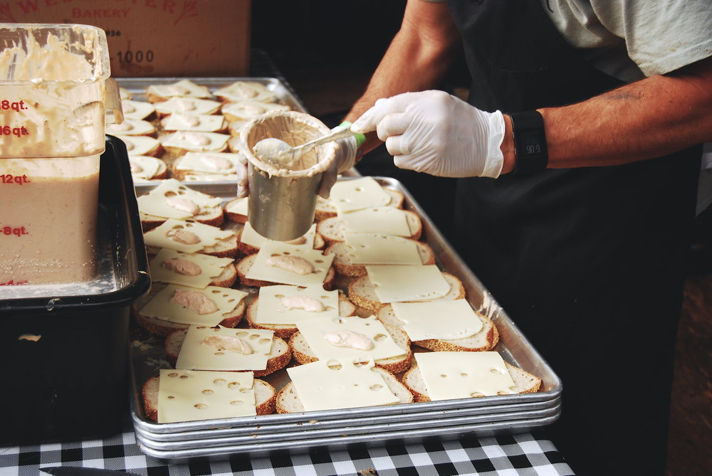 Assembling the pastrami sandwiches at Outside Lands music festival