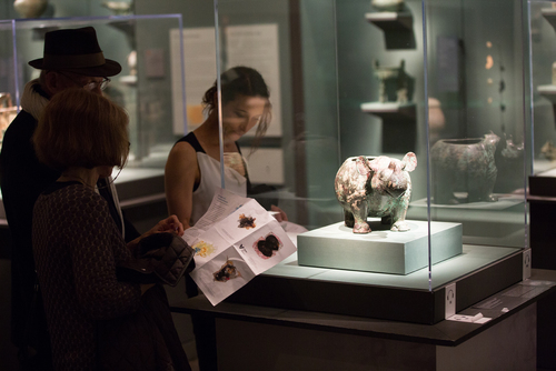 Visitors examine 11th century Chinese bronze vessel in the shape of a rhino, described by Jay Xu.