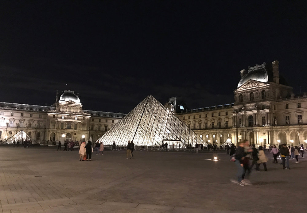The Louvre at night time.