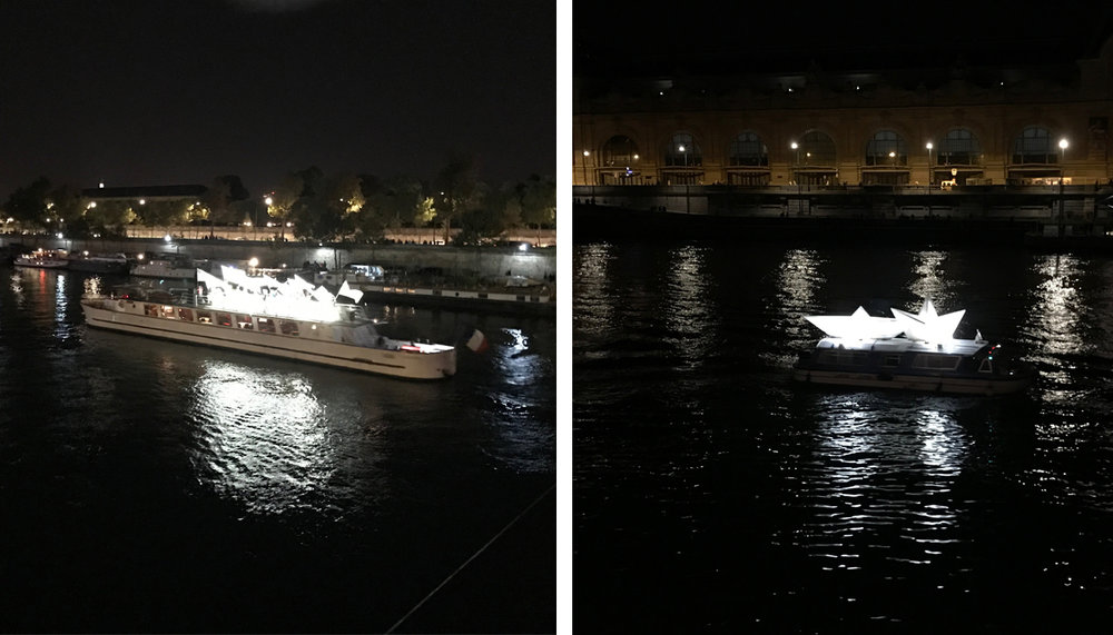 At midnight there was a boat parade on the Seine River. On the left you'll see a boat carrying a bunch of folks waving lit up white flags. It was very beautiful! On the right were two paper boats lit up on a boat - an amusing redundancy.