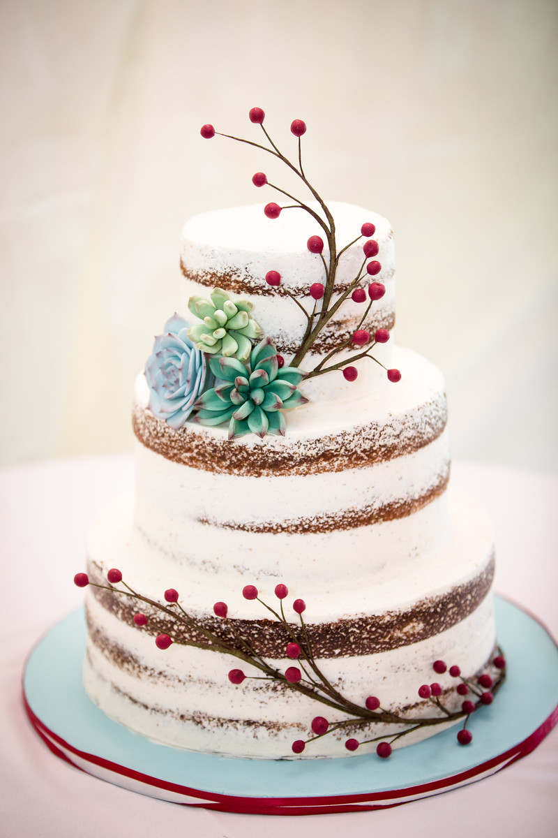 Naked cake with handmade succulents and berry branches